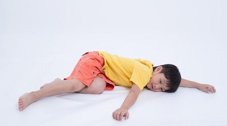 coma: asian boy exhausted fainting sleeping coma Stock Photo
