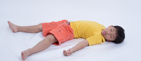 coma: asian boy exhausted sleep injured coma fainting Stock Photo