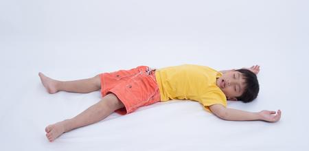 coma: asian boy exhausted fainting injured coma fall sleep Stock Photo