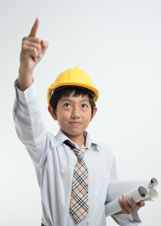 intend: asian boy businessman engineer helmet confident intend paper goal point finger