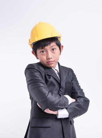 blame: asian boy businessman engineer helmet suit boss leader blame frown Stock Photo
