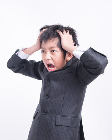 wrathful: asian boy businessman boss leader suit unsuccessful unhappy angry strain serious wrathful crazy problem scream
