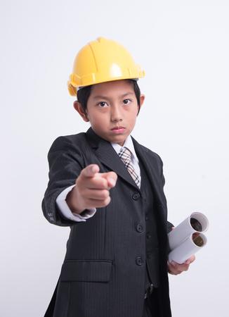 blame: asian boy businessman engineer helmet blame finger point order unsuccessful