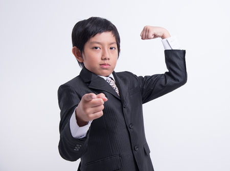 ni�os inteligentes: asian boy businessman confident strong kid boss leader suit