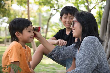 portrait of woman: asian family take care happy sweat cute park mother son boy outdoor