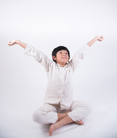 oneself: asian boy up waking couch lassitude wake bed awake oneself hands pyjamas
