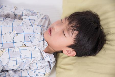 pyjamas: boy asian young bed child sleep bedroom people relax night peaceful dream pyjamas