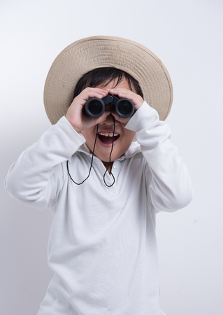 exciting: asian boy looking kid binoculars happy explorer travel hat exciting Stock Photo
