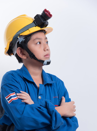 strive: asian boy helmet exploration light kid technician engineer uniform Stock Photo