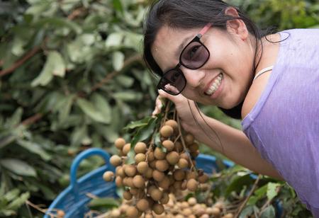 logan fruit woman fresh sweet nature food tree smile thailand