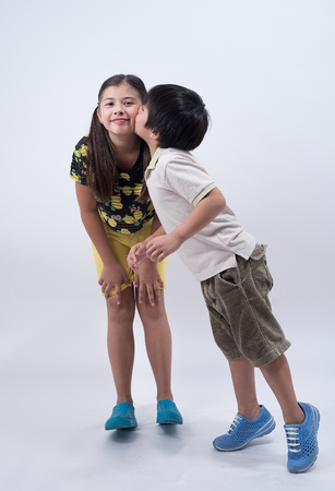 sibling: brother sister love family asian kids cute boy girl young happy kiss sibling Stock Photo