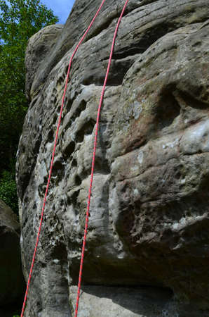 abseil: Rock climbing ropes on rock face