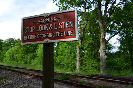 Railroad track crossing sign  photo