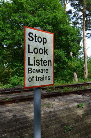 Stop look listen railway crossing sign  photo