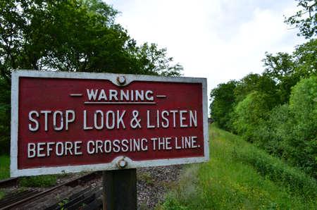 Railway crossing sign in England  Banco de Imagens