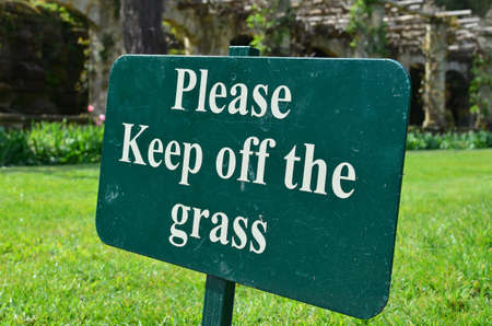 a public notice: please keep off the grass sign Stock Photo