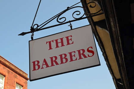 shopfront: Barbers sign outside shop
