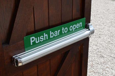 Push bar to open sign on door Banco de Imagens