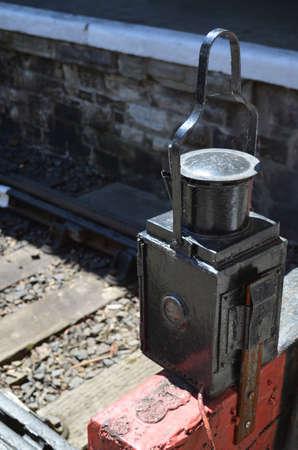Railway station platform stop safety lamp. Banco de Imagens