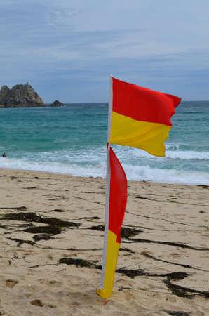 life guard: Life guard warning flags on British beach.