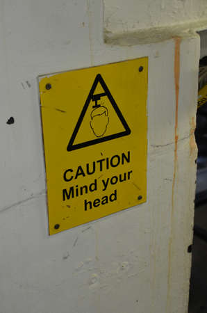 Caution mind you head sign.