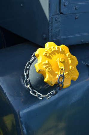diesel: Yellow painted diesel fuel filler cap. Stock Photo
