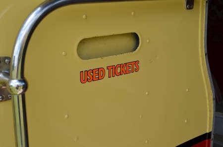 Used ticket bin on public transport bus. Banco de Imagens