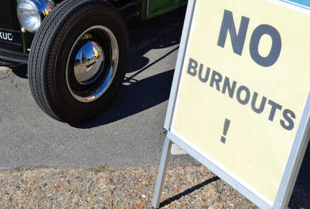 rod sign: No burnouts sign at a hot rod event.