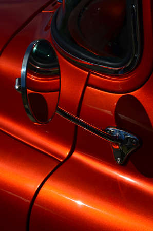 Chrome wing mirror on car.