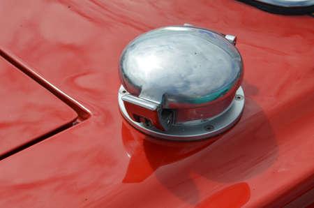 Petrol fuel filler cap on classic race car.