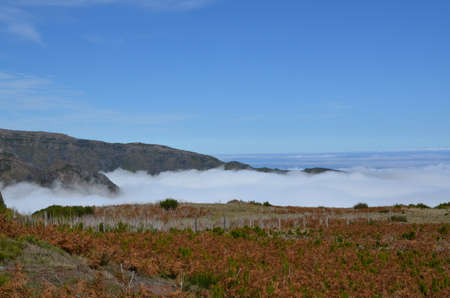 Above the clouds on a mountain range in Madeira. Banco de Imagens