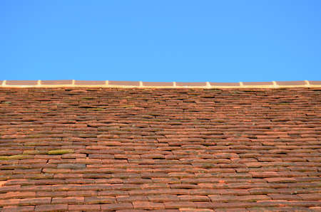 roof ridge: Traditional clay roof tiles. Stock Photo