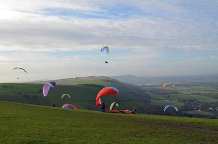 Paragliding above the Sussex Southdowns hill range. Banco de Imagens