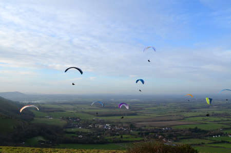hill range: Paragliding above the Southdowns hill range in Sussex.