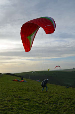 dyke: Paragliding at Devils Dyke in Sussex.