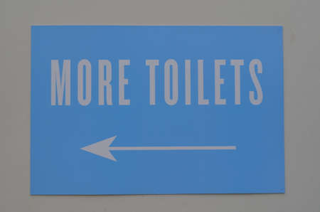 More toilets sign