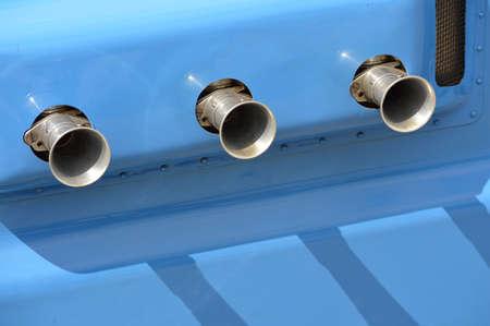 engine carburetor air filter intake pipes on a classic race car. Banco de Imagens