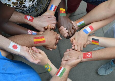 differing: International brothers and sisters in Christ standing in a circle together and holding hands Stock Photo