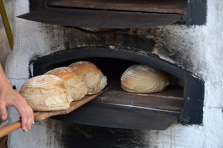 woodburner: freshly baked bread in old timey wood oven Stock Photo