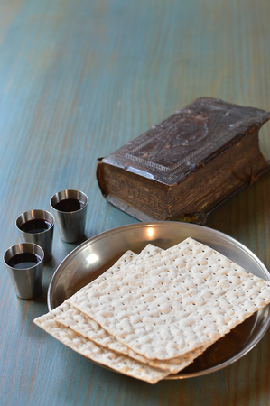 The Lord's Supper with bread, wine and an ancient bible