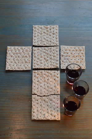 sacrificed: The Lords Supper with bread in the shape of a cross and three little cups of wine