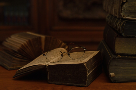 antique books: antique books with reading glasses Stock Photo