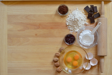 Border of baking ingredients with copy space to the left side