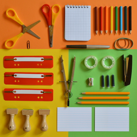 School supplies on colorful paper board as square Stock fotó