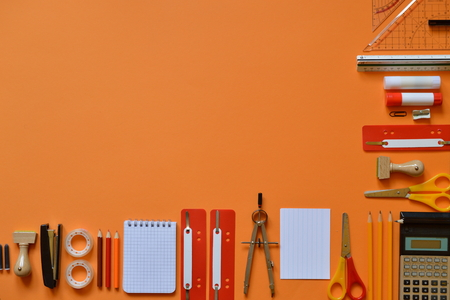 schoolkid: Office or school supplies on orange paper board