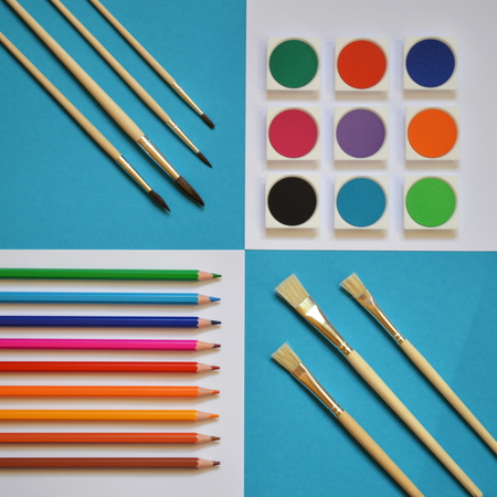 art supplies on a square cyan and white background