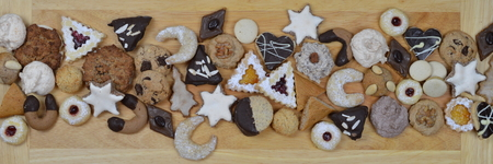 self worth: ribbon out of different kinds of Christmas cookies on a breadboard
