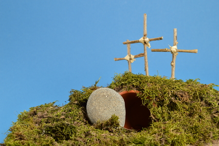 tinkered: resurrection garden as easter decoration with a stone near the empty tomb and three crosses on a hill above