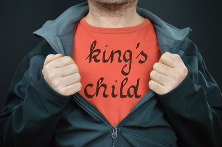 confide: a man with the words kings child on his red t-shirt