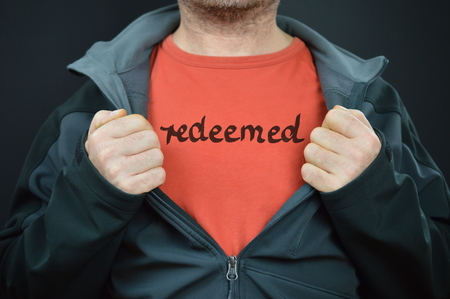 confiding: a man with the word redeemed on his t-shirt